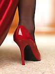 Woman in red high heel shoes