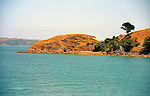 Water and hills of Matiatia Bay on scenic Whaiheke Island in Hauraki Gulf near Auckland New Zealand summer waterscape