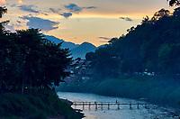 Laos. Luang Prabang. Bamboo bridge across Nam Khan river at sunset.