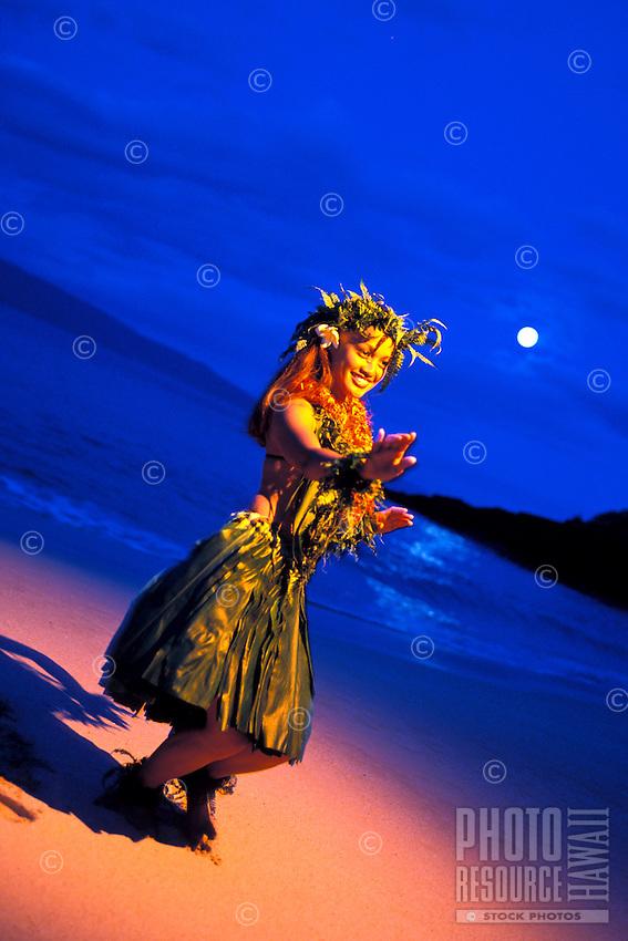 Hula dancer with full moon seeting at Makena, Maui.
