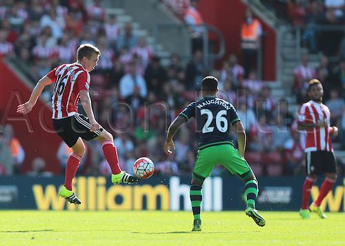 26.09.2015. Southampton, England. Barclays Premier League. Southampton versus Swansea. James Ward-Prowse of Southampton knocks the ball past Kyle Naughton of Swansea
