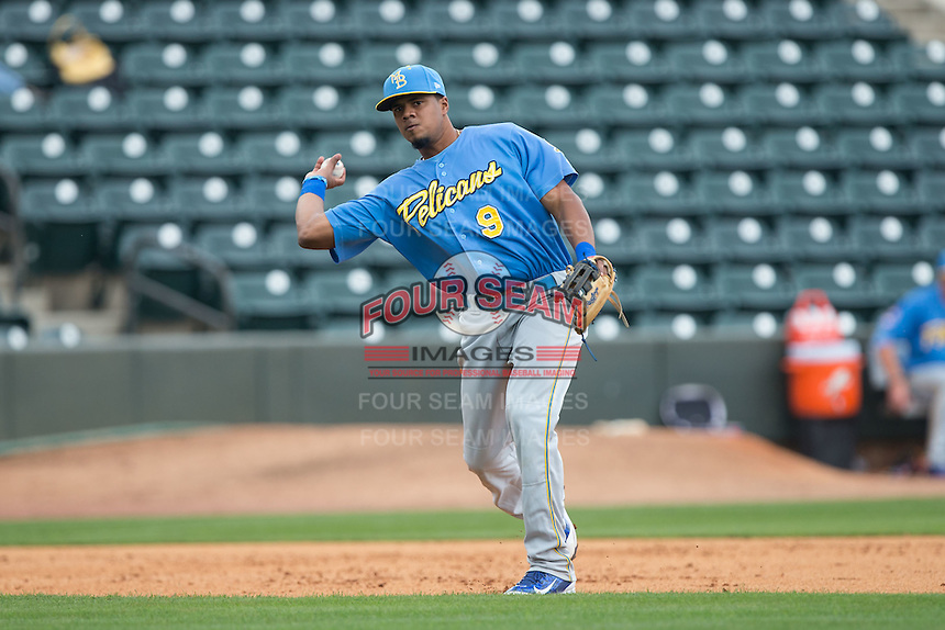 Myrtle Beach Pelicans third baseman Jeimer Candelario (9) makes a throw to first base against the Winston-Salem Dash at BB&T Ballpark on May 10, 2015 in Winston-Salem, North Carolina.  The Pelicans defeated the Dash 4-3.  (Brian Westerholt/Four Seam Images)