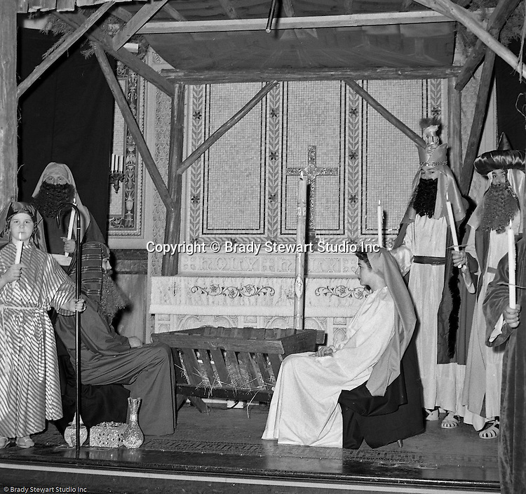 Pittsburgh PA: View of the Christmas play; the birth of baby Jesus, at the First Luthern Church on Grant Street in Pittsburgh - 1958.  Members of the congregation doned period clothing the recreate Christmas night 1958 years earlier.  Mary and Joseph in front of the manager with gifts from the wise men