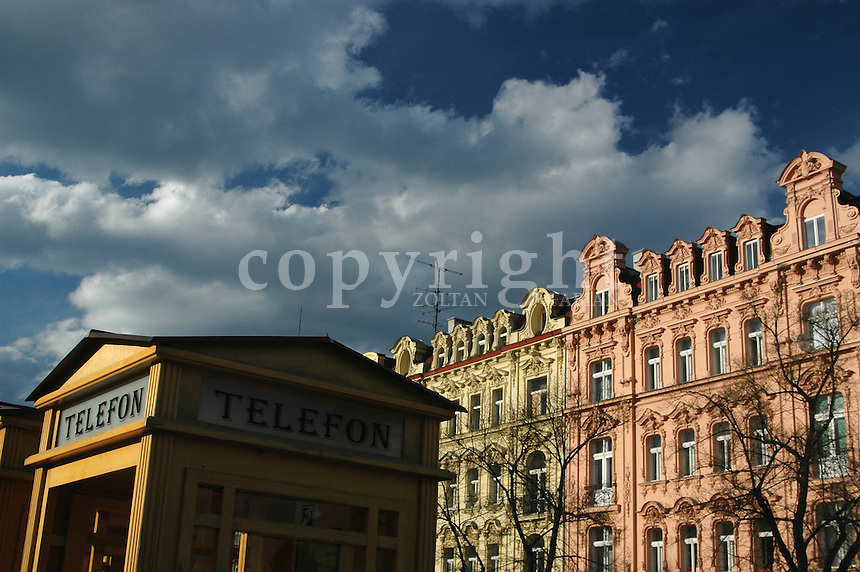 Old style telephone kiosk and classic houses in Karlovy Vary, Czech Republic, Europe