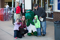 "A family poses for a photo with Kannapolis Intimidators mascot ""Tim E. Gator"" during the South Atlantic League game between the Lakewood BlueClaws and the Kannapolis Intimidators at Kannapolis Intimidators Stadium on April 6, 2017 in Kannapolis, North Carolina.  The BlueClaws defeated the Intimidators 7-5.  (Brian Westerholt/Four Seam Images)"
