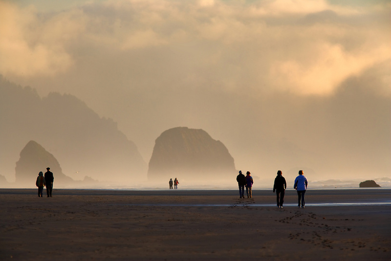 Couples walking on Cannon Beach, Oregon