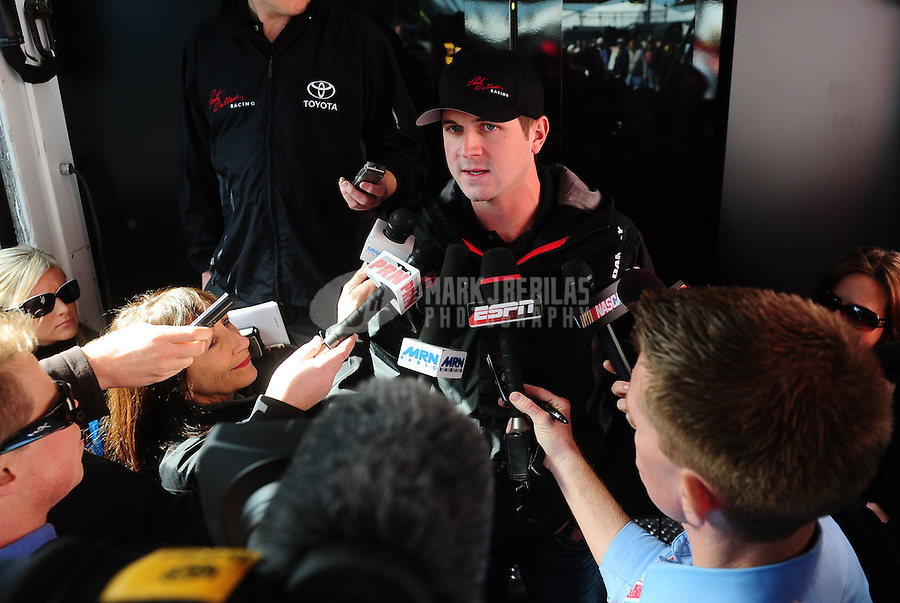 Feb 12, 2011; Daytona Beach, FL, USA; NASCAR Nationwide Series driver Michael Annett speaks to the media in regards to a DUI he recently received during practice for the Daytona 500 at Daytona International Speedway. Mandatory Credit: Mark J. Rebilas-