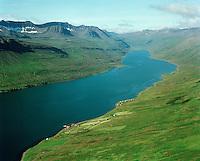 Brekka, Mjóifjörður séð til vesturs, Skógar i bakgrunni langleiðin inn fjörðinn að norðanverðu. Fjarðabyggð áður Mjóafjarðarhreppur /.Brekka, Mjoifjordur viewing west, Skogar in background on the northern side just before where the fiord ends. Fjardabyggd former Mjoafjardarhreppur.