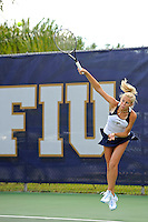 18 March 2012:  FIU's Karyn Guttormsen serves the ball during her singles match against Columbia's Iani Alecsiu as the Columbia Lions defeated the FIU Golden Panthers, 5-2, at University Park in Miami, Florida.