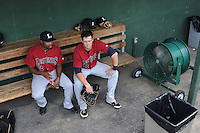 Outfielder Jay Austin (3), left, and infielder Matt Duffy (13) of the Lexington Legends cool off in front of the fan before a game against the Greenville Drive on July 19, 2012, at Fluor Field at the West End in Greenville, South Carolina. Greenville won, 11-10 in 15 innings. (Tom Priddy/Four Seam Images)