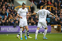 Mateusz Klich of Leeds hands his captain, Luke Ayling a note that was passed from player to player on the instructions of Manager, Marcelo Bielsa during Millwall vs Leeds United, Sky Bet EFL Championship Football at The Den on 5th October 2019
