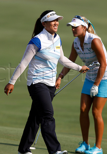 06.07.2012. Kohler, Wisconsin.  Professional Golfer Amy Yang from Korea reacts as she walks by Anna Nordqvist from Sweden on the 18th green at Blackwolf Run in the second round of the U.S. Women's Open Championship in Kohler, Wisconsin.