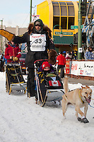 Musher Gerry Willomitzer and Iditarider Benjamin Meyer.leave the 2011 Iditarod ceremonial start line in downtown Anchorage, Alaska