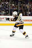February 17th 2007:  Andrew Ference (21) of the Boston Bruins follows through on a slap shot vs. the Buffalo Sabres at HSBC Arena in Buffalo, NY.  The Bruins defeated the Sabres 4-3 in a shootout.