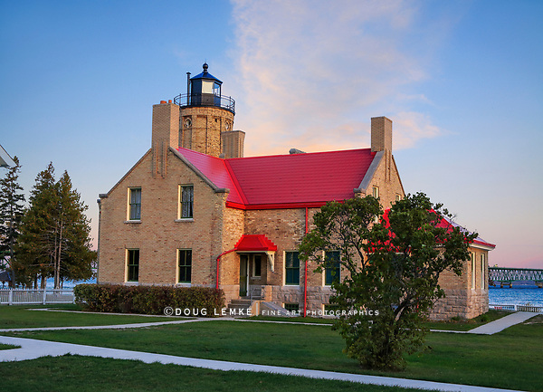 The Old Mackinac Point Lighthouse poised on the Lower Peninsula end of the Mackinac Bridge at the Straits Of Mackinac, Michigan, USA