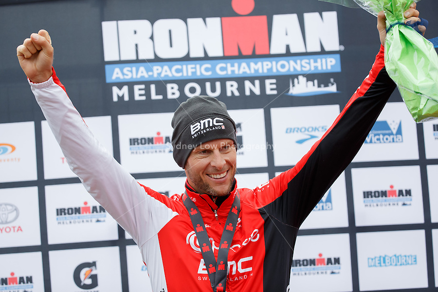 Dirk BOCKEL (LUX) celebrates on the podium after winning the IRONMAN Asia-Pacific Championship in Melbourne, Australia on Sunday March 23, 2013. (Photo Sydney Low / sydlow.com)