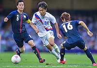August 10, 2012..South Korea's Park Chu-young attempts to run past Japan's Hotaru Yamaguchi in action during bronze medal match at the Millennium Stadium on day fourteen in Cardiff, England. Korea defeat Japan 2-0 to win Olympic bronze medal in men's soccer. ..