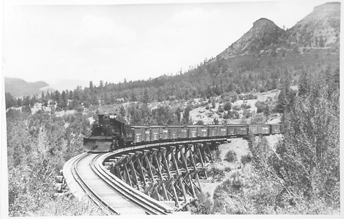 RGS eastbound freight train crossing Bridge 160-A (Lightner Creek Trestle).<br /> RGS  Franklin Junction, CO