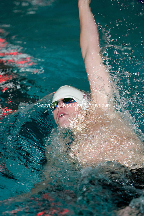 WATERBURY, CT - 29 JANUARY 2010 -012910JT08--<br /> Sacred Heart's Ray Snyder swims in the 100 backstroke during Friday's meet against Naugatuck at Kennedy. Snyder finished first in the event, with a time of :59.13. Naugatuck won the meet, 95-91.<br /> Josalee Thrift Republican-American