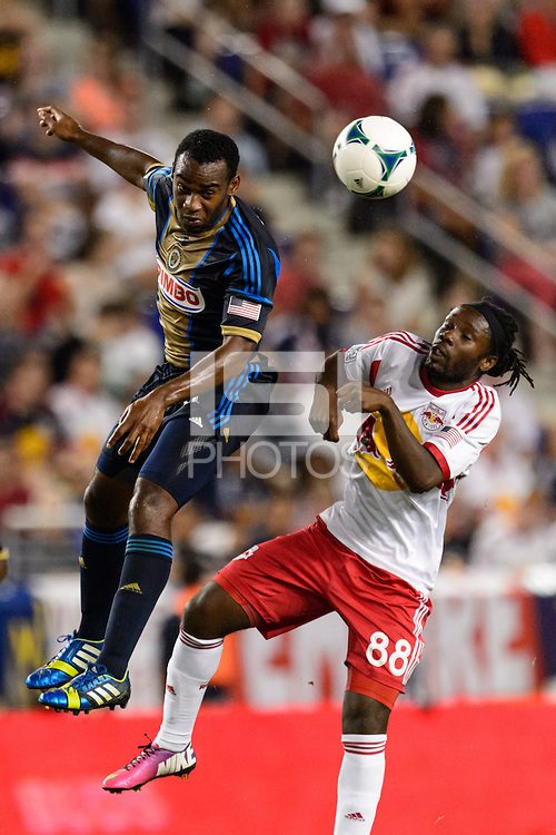 Amobi Okugo (14) of the Philadelphia Union goes up for a header with Peguy Luyindula (88) of the New York Red Bulls. The New York Red Bulls and the Philadelphia Union played to a 0-0 tie during a Major League Soccer (MLS) match at Red Bull Arena in Harrison, NJ, on August 17, 2013.