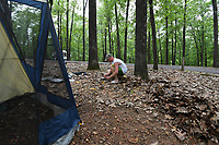NWA Democrat-Gazette/J.T. WAMPLER Taylor Walts of Centerton stakes down his tent Friday May 26, 2017 at the Prairie Creek Recreation Area & Campground near Rogers. More Americans are expected to travel this holiday weekend since 2005 and Arkansas state park campgrounds were nearing capacity as of Friday afternoon.