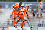 24 August 2013: Carolina's Julius James (TRI) (left) and Nick Millington (GUY) (14) challenge for a header with Minnesota's Kevin Venegas (behind). The Carolina RailHawks played the Minnesota United FC Loons at WakeMed Stadium in Cary, NC in a 2013 North American Soccer League Fall Season game. Carolina won 1-0.