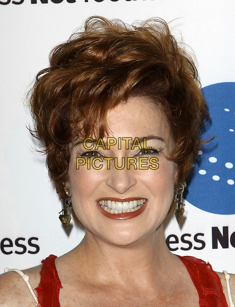 CAROLYN HENNESY.A Smile For Every Child Gala held At Shangri-La Hotel, Santa Monica, California, USA..September 10th, 2009.headshot portrait smiling teeth red lipstick dangling gold earrings .CAP/ADM/KB.©Kevan Brooks/AdMedia/Capital Pictures.
