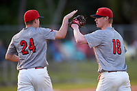 Illinois State Redbirds pitcher Jake Sale (24) and relief pitcher Jack Landwehr (18) celebrate after a game against the Ohio State Buckeyes on March 5, 2016 at North Charlotte Regional Park in Port Charlotte, Florida.  Illinois State defeated Ohio State 5-4.  (Mike Janes/Four Seam Images)