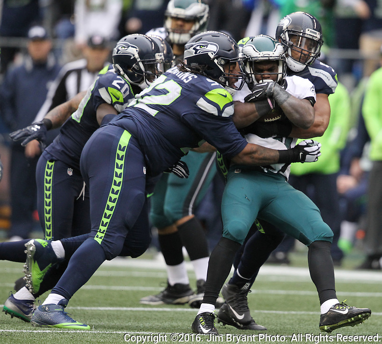 Seattle Seahawks defensive tackle Sealver Siliga (92) and middle linebacker Bobby Wagner (54) drops Philadelphia Eagles Running back Kenjon Barner (34) for a loss<br /> at CenturyLink Field in Seattle, Washington on November 20, 2016.  Seahawks beat the Eagles 26-15.  &copy;2016. Jim Bryant Photo. All Rights Reserved.