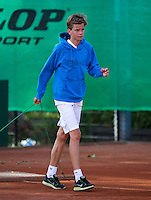 August 9, 2014, Netherlands, Rotterdam, TV Victoria, Tennis, National Junior Championships, NJK,  Final boys 14 years Alec Deckers (NED)  wins and swipes the clay court<br /> <br /> Photo: Tennisimages/Henk Koster