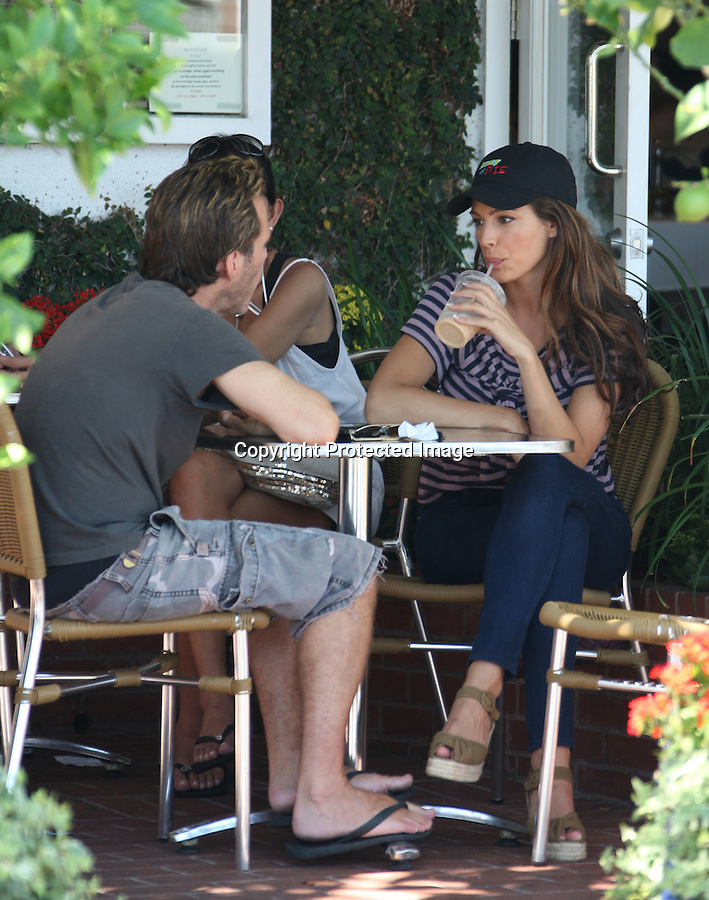 ".August 20th 2010..Fred Segal in Hollywood .Kelly Brook drinking a strawberry smoothie & eating lunch with 2 guys. Kelly looked very pretty wearing tight blue jeans showing off her big butt. Kelly was carrying a maroon Chanel Purse, pink blue stripped shirt tied in front. Kelly seems to have a sense of humor as she sported a Will Ferrell ""Funny or Die"" hat...AbilityFilms@yahoo.com.805-427-3519.www.AbilityFilms.com."