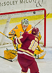 19 February 2016: University of Vermont Catamount Goaltender Packy Munson, a Freshman from Hugo, MN, has one sail just over the crossbar in the third period against the Boston College Eagles at Gutterson Fieldhouse in Burlington, Vermont. The Eagles defeated the Catamounts 3-1 in the first game of their weekend series. Mandatory Credit: Ed Wolfstein Photo *** RAW (NEF) Image File Available ***