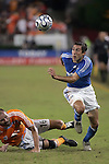 10 November 2007:  Davy Arnaud (r) tries to avoid a slide tackle by Craig Waibel (16) of the Houston Dynamo.  The MLS Houston Dynamo defeated the Kansas City Wizards 2-0 at Robertson Stadium, Houston, Texas to capture the 2007 MLS Western Conference title and to advance to the MLS Cup championship final on Saturday, November 18th.