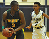 Jonathan Dean #3 of Westbury, left, looks to pass during a Nassau County varsity boys basketball game against host Baldwin High School on Tuesday, Jan. 17, 2017. Westbury won by a score of 63-57.