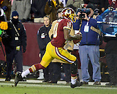 Washington Redskins quarterback runs 10 yards for a touchdown late in the third quarter against the Dallas Cowboys at FedEx Field in Landover, Maryland on Sunday, December 30, 2012.  The Redskins won the game 28 - 18 to capture the NFC East title..Credit: Ron Sachs / CNP.(RESTRICTION: NO New York or New Jersey Newspapers or newspapers within a 75 mile radius of New York City)
