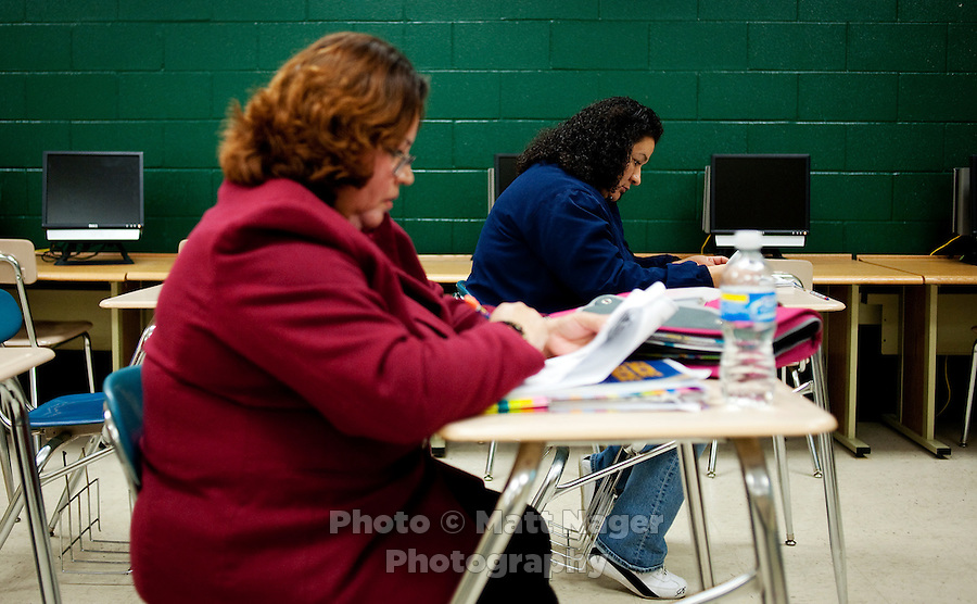 Micaela Madriga (cq, in red, age 44) and other adults participate in an English learning program designed to help teach and read English as well as prepare for the US Citizenship test at the Nixon High School Literacy Center in Laredo, Texas, US, Wednesday, Dec. 9, 2009. With over 95 percent of the population as Hispanic Spanish speakers, Laredo ranked the lowest in literacy rates in the 2000 US census. Today there are a number of bi-lingual and dual language classes set up to help students and adults learn english...PHOTOS/ MATT NAGER