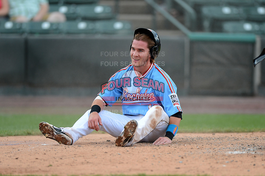 Rochester Red Wings catcher Chris Herrmann #18 sits on the ground after being tagged out at home during a game against the Gwinnett Braves on June 16, 2013 at Frontier Field in Rochester, New York.  Rochester defeated Gwinnett 6-3.  (Mike Janes/Four Seam Images)