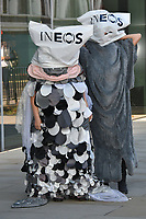 Joseph Corr&eacute;, activist and son of Dame Vivienne Westwood and the late Malcom McLaren takes part in anti-plastic and anti-fracking photocall, featuring a six foot penguin, dolphin, fish and seagull with plastic bags over their heads to raise awareness of ocean conservation, at World Sailing HQ,<br /> #BreakFreeFromPlastic photocall, London, UK - 10 October 2018.<br /> CAP/JOR<br /> &copy;JOR/Capital Pictures