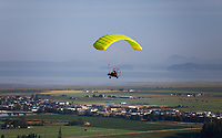 Yellow Powered Parachute in Flight over Skagit Valley, Arlington, Washington State, WA, America, USA.