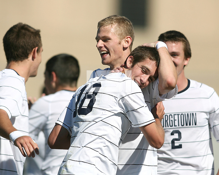 Steve Neumann #18 of Georgetwn University is congratulated after scoring the first goal during a Big East match against Villanova University at North Kehoe Field, Georgetown University on October16 2010 in Washington D.C. Georgetown won 3-1.