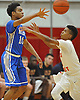Justin Cole #10 of Archbishop Molloy, left, passes away from Matt Asenjo #3 of Half Hollow Hills West during a varsity boys' basketball game at Long Island Lutheran High School on Sunday, Jan. 3, 2016. Archbishop Molloy defeated Hills West by a score of 70-56.