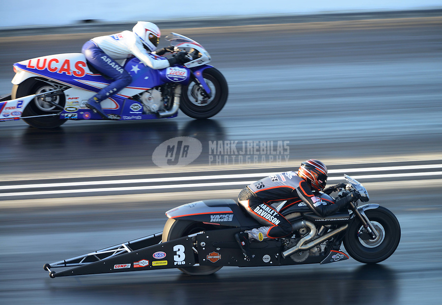 Jul. 1, 2012; Joliet, IL, USA: NHRA pro stock motorcycle rider Hector Arana Jr (far lane) races alongside Andrew Hines during the Route 66 Nationals at Route 66 Raceway. Mandatory Credit: Mark J. Rebilas-
