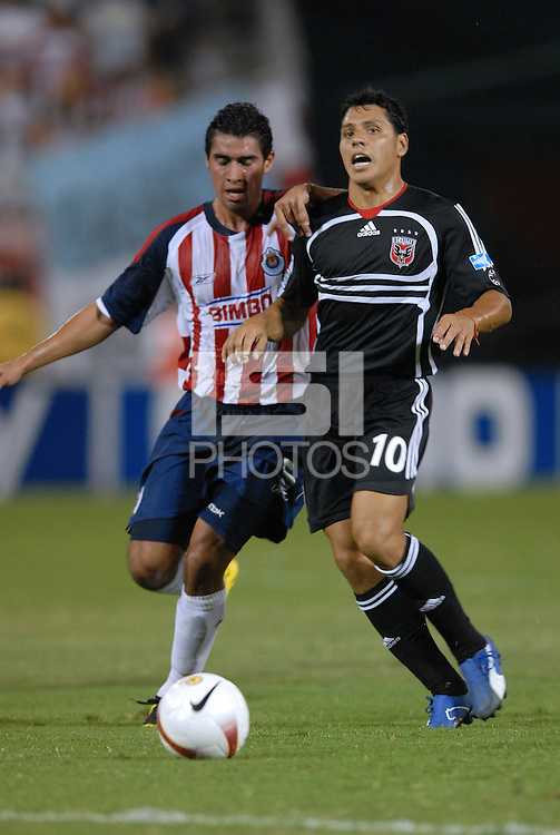 DC United midfielder Christian Gomez (10) fights for possession of the ball against CD Chivas midfielder Patricio Araujo (5). DC United defeated CD Guadalajara 2-1 in the first game of a home and home round of 16 match in the 2007 Copa Nissan Sudamericana at RFK Stadium in Washington DC, on Wednesday September 26, 2007.