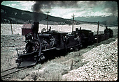 C&amp;S #71 leads #8 (dead), a couple of gons and #69 through the dredger debris along the Blue River near Breckenridge.  This was as the road was being scrapped in 1938.<br /> C&amp;S  Breckenridge, CO  1938