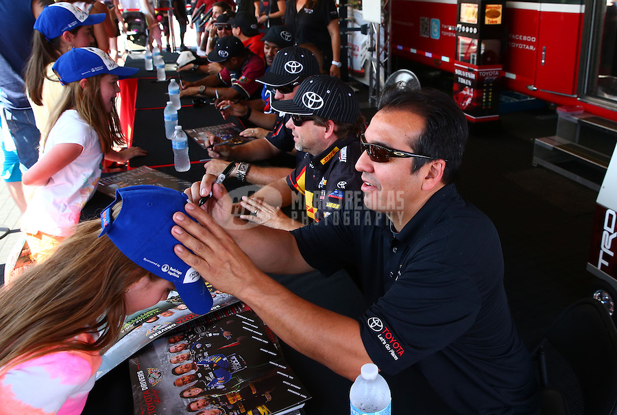 Jun. 1, 2013; Englishtown, NJ, USA: NHRA funny car driver Tony Pedregon signs autographs during qualifying for the Summer Nationals at Raceway Park. Mandatory Credit: Mark J. Rebilas-