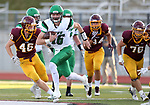 HARRISBURG, SD - SEPTEMBER 26: Peyton Zabel #16 from Pierre scrambles away from a host of defenders including Sam Loos #46 from Harrisburg in the second half of their postponed game Tuesday evening in Harrisburg. (Photo by Dave Eggen/Inertia)