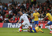 Adam Armstrong (Barnsley, loan from Newcastle United) of England shakes off an Allan of Brazil challenge during the International match between England U20 and Brazil U20 at the Aggborough Stadium, Kidderminster, England on 4 September 2016. Photo by Andy Rowland / PRiME Media Images.
