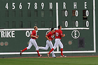 Members of the Greenville Drive pitching staff run in the outfield following a Media Day first workout of the season on Tuesday, April 7, 2015, at Fluor Field at the West End in Greenville, South Carolina. (Tom Priddy/Four Seam Images)