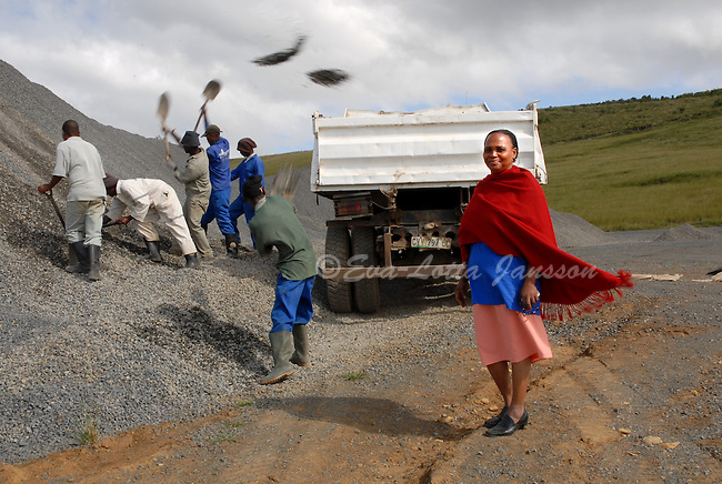 Agnes Mzobotshi at Mzintlava Quarries, in Lusikisiki in the Eastern Cape, as workers load stone mined at the small-scale into a truck. Mzobotshi owns the quarry together with Rose Williams. ....The two women have given a 10 percent share in the business to the community through a trust, and have hired a core staff of six employees, who are either widows of mine workers or retrenched mineworkers themselves. ....The mine also hires workers from the community on a casual and rotating basis, so as to spread income throughout the unemployment-ravished community. When they are able to raise the funds they need to move further ahead, they are planning to hire another 100 workers...
