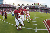 STANFORD, CA -- August 31, 2012: Stanford team captains walk on the field for the coin toss before the Stanford vs San Jose State University game Friday night at Stanford Stadium.<br /> <br /> The Cardinal defeated the Spartans 20-17.